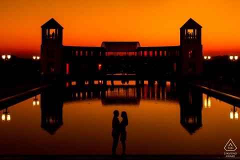 Curitiba, Brazil couple portrait with an orange silhouette | Buildings, Water, Dusk