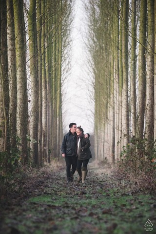 Bridgnorth Couple walking during portrait session in the tall woods