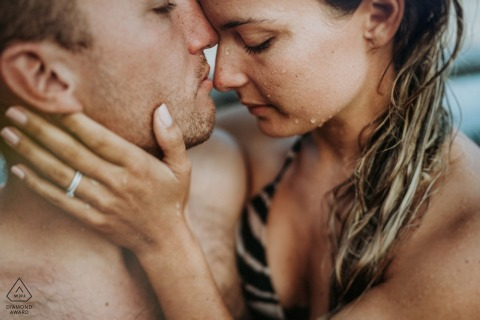 Marrakech beach photography session for engagement portraits | A man and a woman embracing