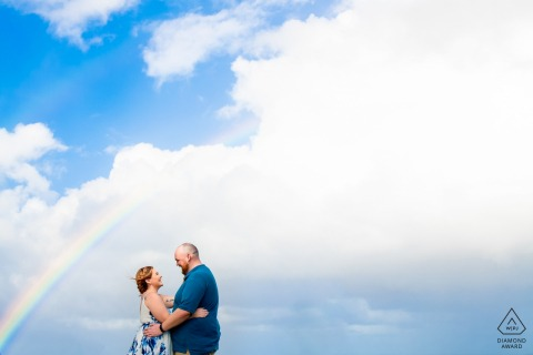 El Morro, San Juan PR prewedding portrait photographer: Perfect timing with a rainbow, just one light over couple