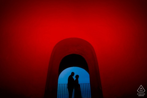 El Morro, San Juan PR pre-wedding photographer: One red Gel on Profoto A1 for Wall and exposed for couples silohuette.