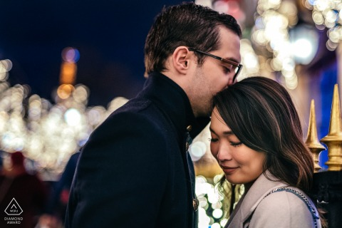 Engagement portrait session for a couple at night in Avenue Montaigne, Paris