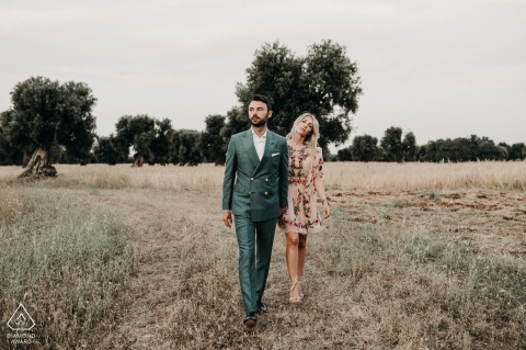 Ostuni, Puglia engagement portraits for a couple walking among the olive trees