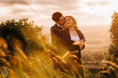 Devil's Dyke, nr Brighton, UK engagement photography - Romantic image of Ella and David at golden hour on Devil's Dyke