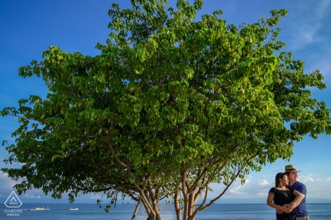 Couple next to a tree in Punta Mita during engagement photo session.