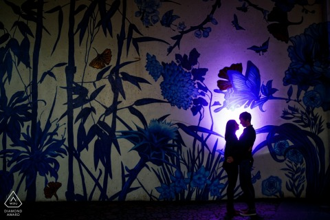 ping tom park couple silhouette in front of a mural with a spot light - IL engagment photography