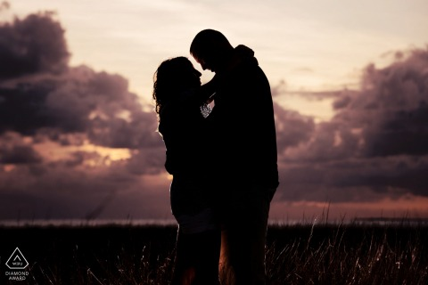 Key West Silhouette engagement Photo at Sunset with Clouds
