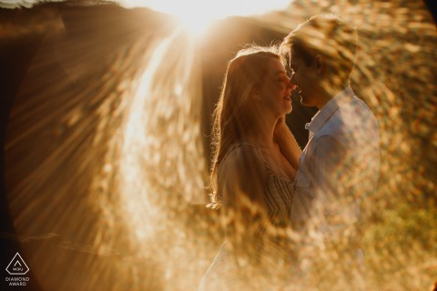 Rio Grando do Sul couple during engagement session with sun ring effect
