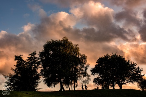Heaton Park, Manchester. UK - Sunset silhouette engagement photo shoot in the park