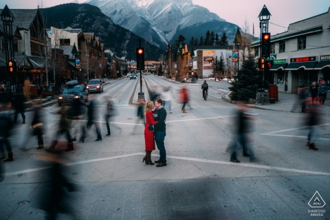 Banff, AB, Canada engagement portraits with an invisible couple in the streets with blurred and moving people