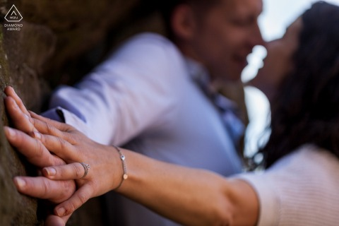 Engagement picture of couple and ring detail in the Saverne Forest