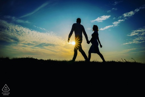 Brummen couple portrait image - With the sunrise, the couple walk together to the future with their baby