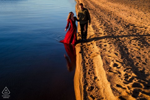 4H Club South Lake Tahoe engagement pictures of Ying and Yang love | walking on the sand and water