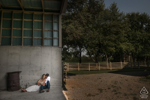 Collingwood, Ontario Engagement Portrait of a couple sitting in barn.