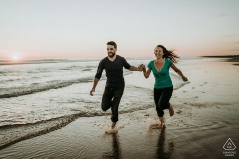 Ile d'Oléron France Couple Running for Fun on the Beach Sand