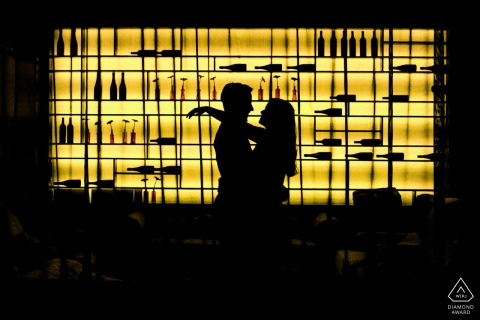 City Lounge Apeldoorn image of a Couple before lightened wine wall