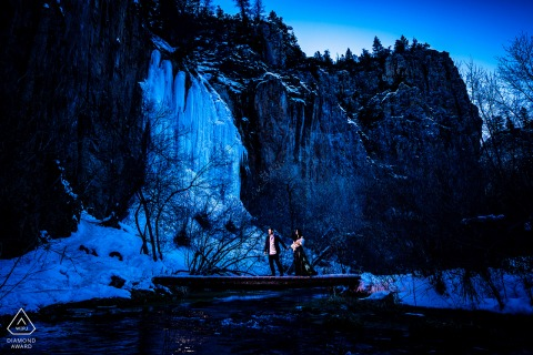 Rifle Falls, CO couple picture - walking across frozen river in winter