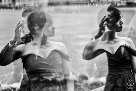 dumbo couple with reflection - pre-wedding image in black and white