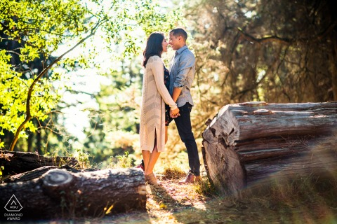 Oakland Hill pre-wedding picture of a couple - Romancing in the woods