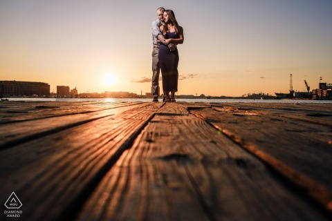 Engagement Photo from Fells Point, Baltimore, MD - Sunrise on a dock in Baltimore, lit with softbox.