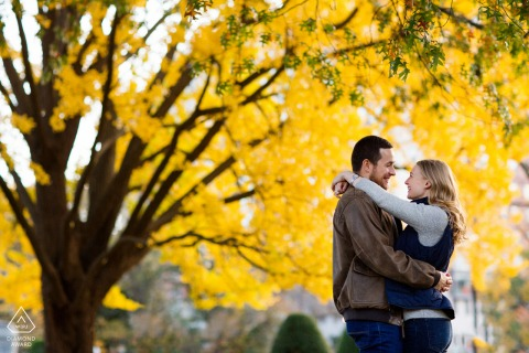 Couple Engagement Photos | Boston, MA couple holding each other amongst trees displaying their colors of fall