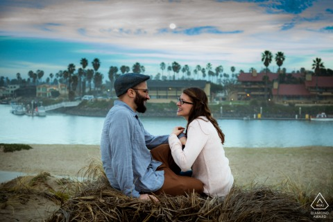 Couple at the beach on an evening with a full moon at the Marina Park, Ventura, CA