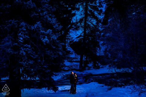 A couple during a  blue hour portrait in Bailey, Colorado
