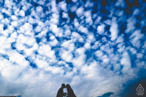 marocco engagment shoot of a couple against a blue sky with beautiful clouds