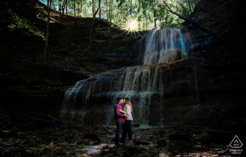 Engagement portrait at the bottom of a waterfall at Hamilton Falls, Canada