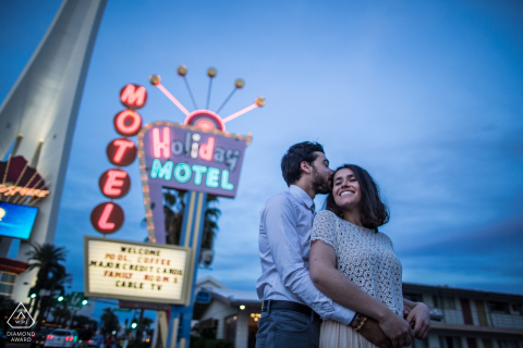 LAS VEGAS ENGAGEMENT PORTRAIT | A COUPLE JUST HAPPY IN FRONT OF THE MOTEL