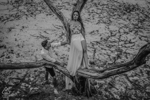 Linhares, Espírito Santo, Brazil engagement photo session in a tree with a young couple in black and white