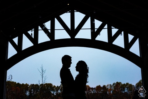 Longwood garden pre-wedding couple portraits under an arch