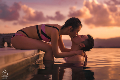 Samujana Villas, Koh Samui engagement photographer: The couple were kissing by a lake.