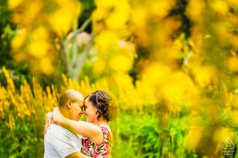 "Engagement Photographer: ""These yellow flowers were in full bloom at the Cape Town botanical gardens and I made use of the vibrant colours to spice up the love."""