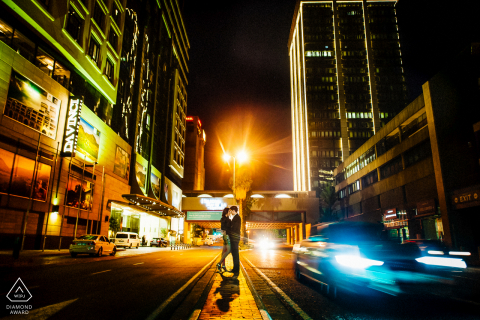 "Johannesburg city centre - South Africa Wedding Photographer:  ""The couple opted for a 'night shoot in the city' theme. I used the vibrant colours and motion to make this image pop."""