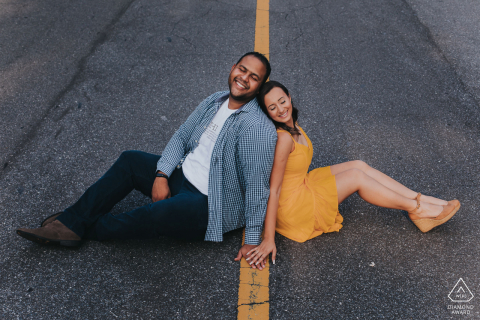 Belo Horizonte, Brazil couple sitting on a painted yellow line on a road during a prewed shoot