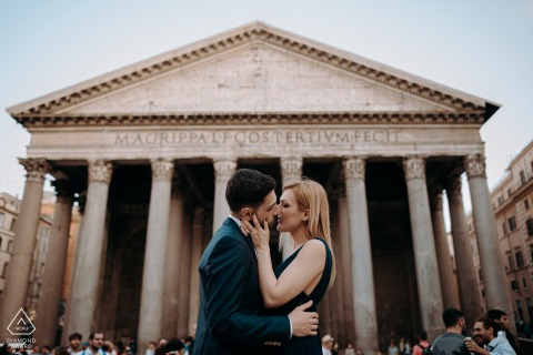 Roma Engagement session with a symmetrical composition and a centered kissing couple