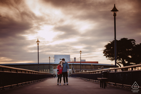 A couple walks together on the pier of the New Brighton Pier, Christchurch, New Zealand