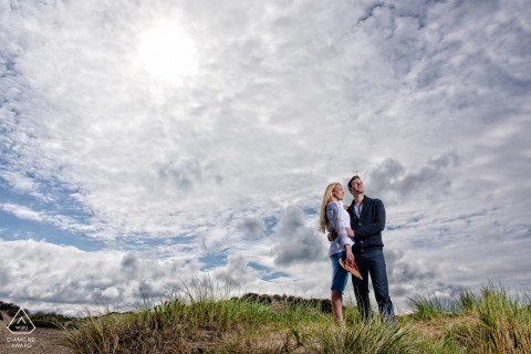 England pre-wedding couple engagement session in Dorset against the clouds