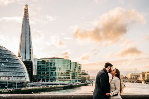 Couple embracing with London Shard in background by the Thames, London, UK