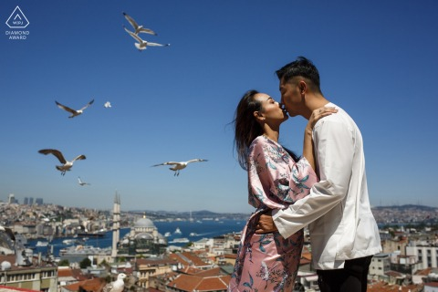 istanbul couple shooting at sultanahmet with birds flying overhead against the blue sky