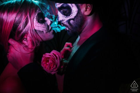 Creative engagement portrait of a love story in the style of a carnival of death