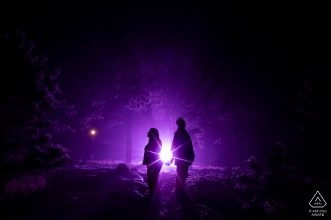 The mountaintop was blanketed in fog the night of these ladies' engagement session, and we included their wedding purple in the backlight at Lookout Mountain, Golden Colorado