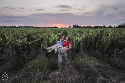 An engaged couple portrait in vineyard fields in Parnay, France