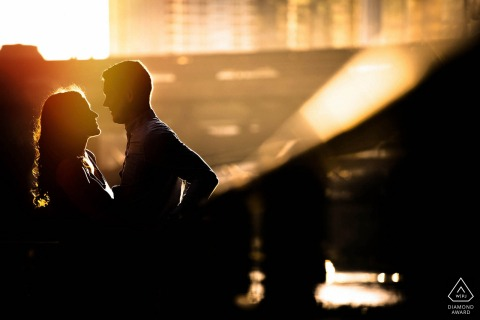 a young Chicago couple pose in the afternoon light for a warm engagement portrait