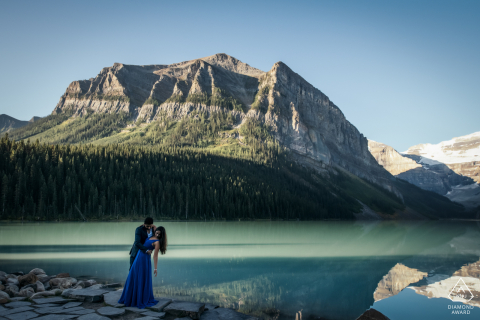 Lake Louise, Banff National Park, AB, Canada engagement portrait session with a Hug by the lake