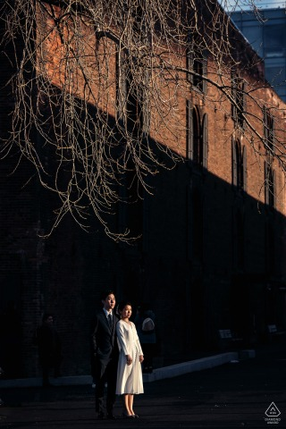 dumbo Portrait of engaged couple in afternoon sunlight