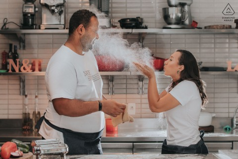 Couple play cooking in a kitchen during a photoshoot in Belo Horizonte, Brazil