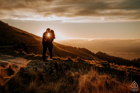 Port Hills, Christchurch engaged Couple at Sunset in the hills for a New Zealand portrait session