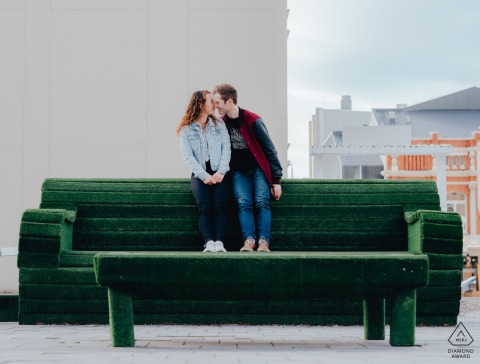 Christchurch Couple on large art installation couch in the streets of New Zealand